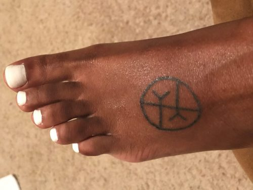 Morgan says: I've always been really sensitive to other people's feelings. The last year or two I recognized that I was extremely empathetic, to the point where I could feel other people's energy or pain. I wanted to get a tattoo that represented how I put myself in other people's shoes all the time. So I got the empathy symbol on my foot. I love how on the outside of me, people see what's going on the inside me, sort of.